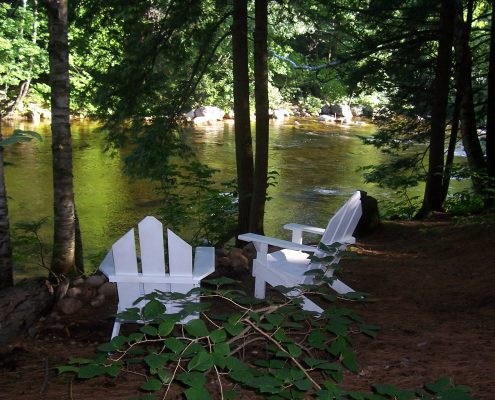 Relax by the Saco River in backyard